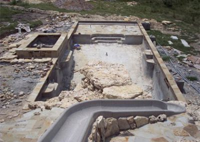 custom-pool-with-rock-slide-construction