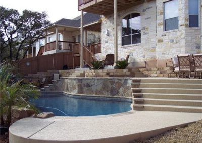 in-ground-swimming-pool-with-elevated-deck