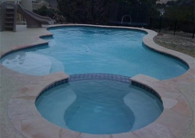 texas-swimming-pool-and-spa-with-six-foot-slide